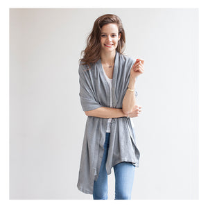 model wearing Mothers Cocoon Grey Marl Breastfeeding Shawl as wrap  | Multi-use nursing shawl | Storksak – Award-winning Baby Changing Bags & Accessories