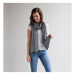 model wearing Mothers Cocoon Grey Marl Breastfeeding Shawl as scarf | Multi-use nursing shawl | Storksak – Award-winning Baby Changing Bags & Accessories