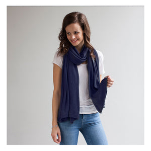 model wearing Mothers Cocoon Navy Breastfeeding Shawl as scarf | Multi-use nursing shawl | Storksak – Award-winning Baby Changing Bags & Accessories