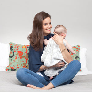 baby wearing baby muslins Storksak bamboo and cotton | storksak natural and organic collection | Storksak – Award-winning Baby Changing Bags & Accessories