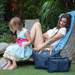 model with Noa navy Baby Changing Bag | shoulder bag Changing Bag | Storksak – Award-winning Baby Changing Bags & Accessories