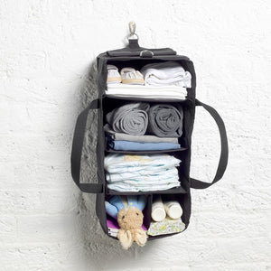Storksak Travel Duffel Black hospital bag hanging organiser on hook filled | Maternity hospital bag | Storksak - Award-winning Baby Changing Bags & Accessories