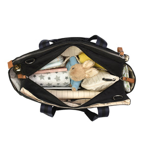 Storksak Travel Shoulder bag black changing Bag internal view filled | Shoulder bag | Storksak - Award-winning Baby Changing Bags & Accessories