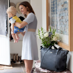 model with Noa leather Black Baby Changing Bag | shoulder Changing Bag | Storksak – Award-winning Baby Changing Bags & Accessories