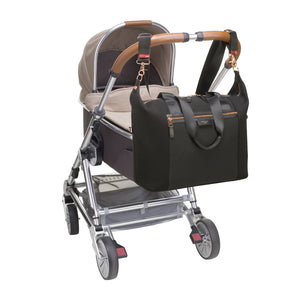 Stevie luxe scuba black | storksak changing bag | Bag attached to pram with stroller clips