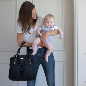 Model wearing Alexa Black Baby Changing Bag | Shoulder Bag Changing Bag | Storksak – Award-winning Baby Changing Bags & Accessories