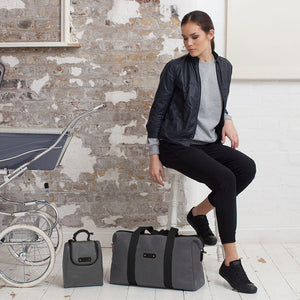 Model with Storksak Bailey Charcoal hospital bag and matching insulated food & bottle bag | Maternity hospital bag | Storksak - Award-winning Baby Changing Bags & Accessories
