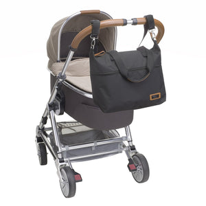 Storksak Travel Expandable tote Black hospital bag on buggy | Maternity hospital bag | Storksak - Award-winning Baby Changing Bags & Accessories