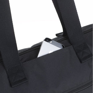 Storksak Travel Expandable tote Black hospital bag close up of front pocket | Maternity hospital bag | Storksak - Award-winning Baby Changing Bags & Accessories