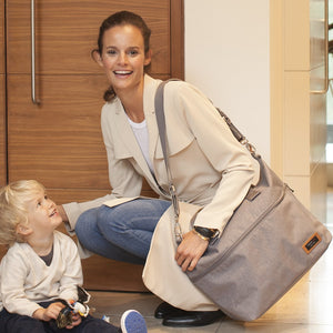 Model wearing Storksak Travel Expandable tote Grey hospital bag | Maternity hospital bag | Storksak - Award-winning Baby Changing Bags & Accessories