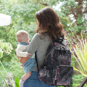 Mum wearing hero floral backpack | storksak changing bag | black diaper bag