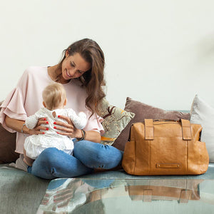 model with Kym Leather Tan Baby Changing Bag | Shoulder Bag Changing Bag | Storksak – Award-winning Baby Changing Bags & Accessories