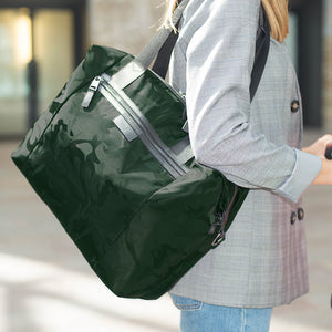 Stevie luxe Camo emerald | storksak changing bag | Mum wearing bag and pushing pram