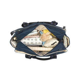 Storksak Travel Shoulder bag Navy changing Bag internal view filled | Shoulder bag | Storksak - Award-winning Baby Changing Bags & Accessories