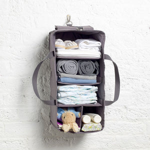 Storksak Travel Duffle Grey hospital bag hanging organiser on hook filled | Maternity hospital bag | Storksak - Award-winning Baby Changing Bags & Accessories