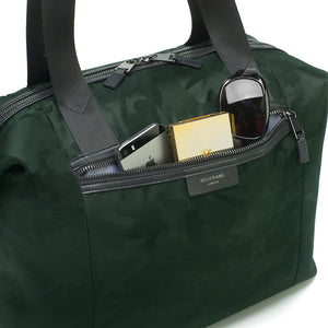 Stevie luxe Camo emerald | storksak changing bag | Large zipped front pocket | textured nylon