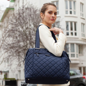 Stevie Quilt navy | storksak changing bag | Mum wearing shoulder bag | work bag and baby bag |