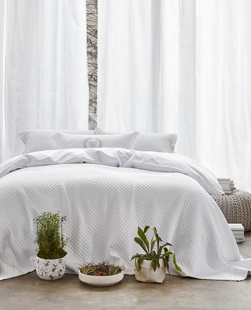 beautiful-white-bed-plants-white-curtains