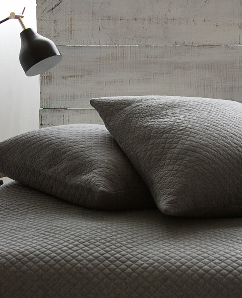 charcoal-grey-diamond-quilted-pillows-blanket-bedding