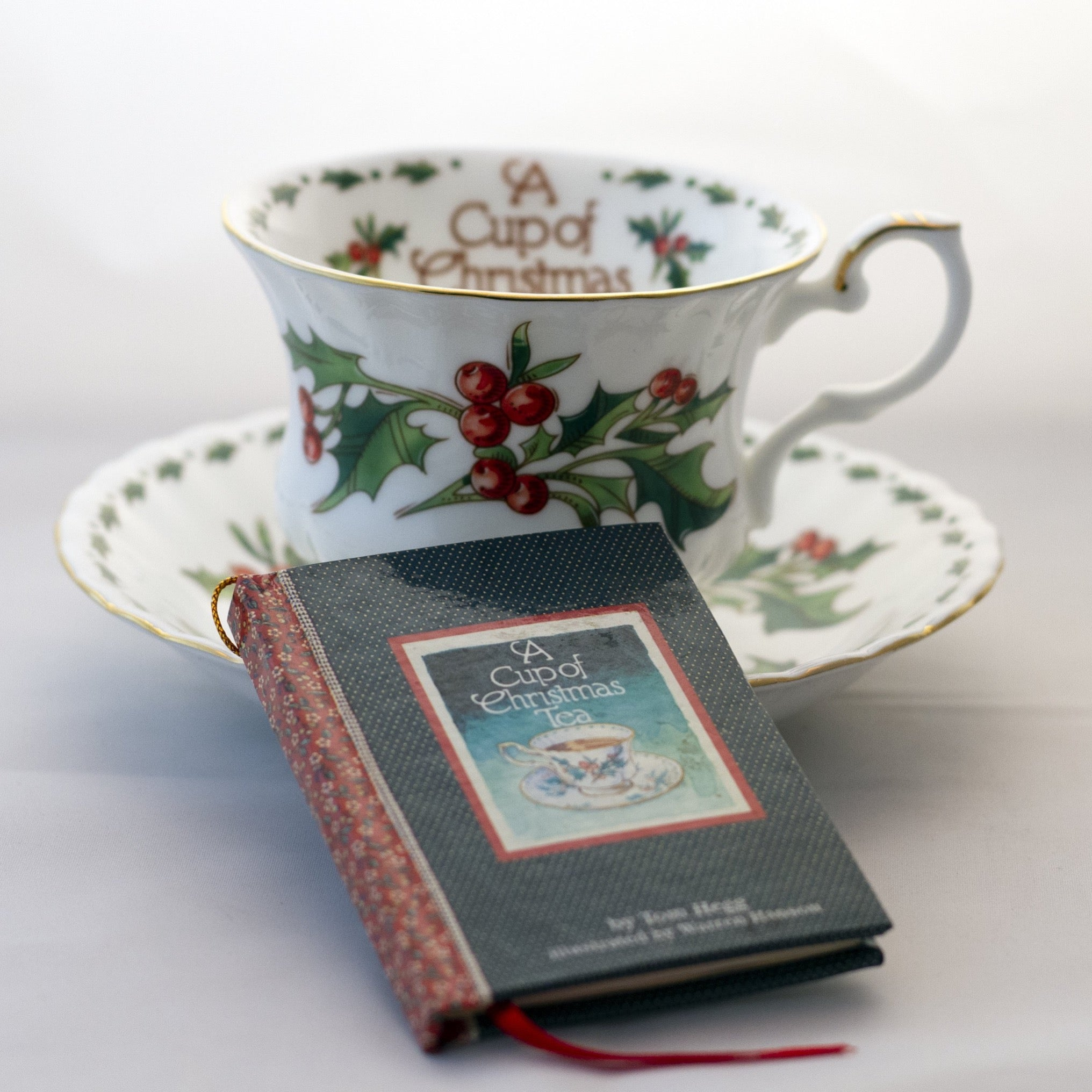 "Waldman House ""A CUP OF CHRISTMAS TEA"" Footed Teacup and Saucer with Matching Ornament Size Tom Hegg Book Circa 1992"