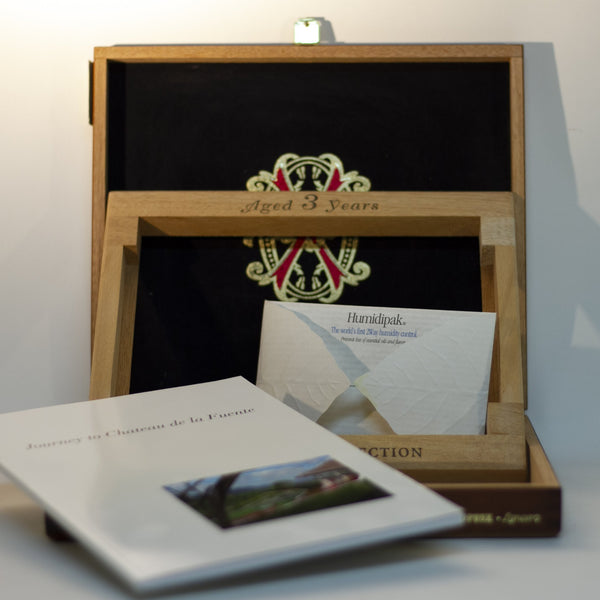 Gift for cigar connoisseur! CHATEAU de la FUENTE WOOD CIGAR BOX for FUENTE FUENTE OPUSX LANCERO cigars. Held 2006 limited-edition set containing 4 rare Fuente Fuente OpusX cigars, photo essay book, Journey to Chateau de la Fuente, and travel size Humidipak. Only 2,500 made and sold; box stamped 803 out of the 2500.