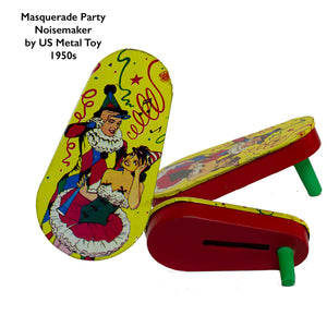 TIN-LITHOGRAPH RATCHET-STYLE MASQUERADE PARTY 1950s NOISEMAKER with green plastic handle by US Metal Toys depicting masquerade dressed couple; the man is dress in a harlequin print jester outfit and the woman in a short cha-cha dress. Lithograph is festive and bright; the background filled with streamers and confetti.