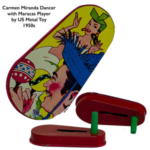 "TIN-LITHOGRAPH RATCHET-STYLE CARMEN MIRANDA NOISEMAKER made by US Metal Toys from the late 1940s to 1950s with lithograph depicting ""The Brazilian Bombshell, Carmen Miranda"" dancing to maracas. Lithograph is in great condition with festive colors and no scratches or rust."