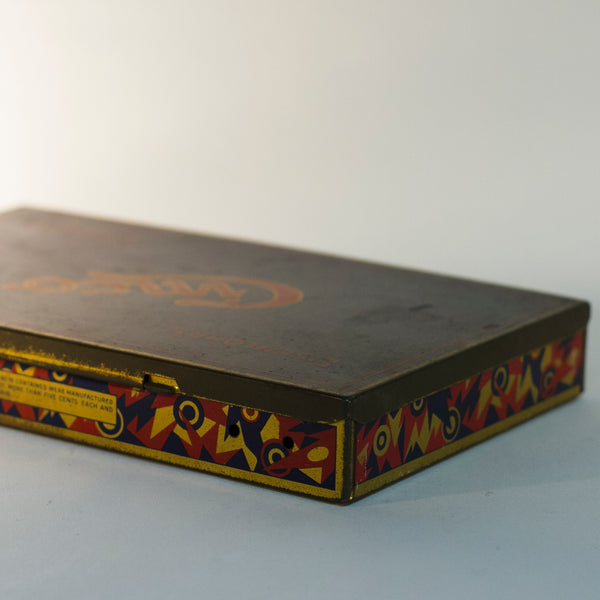 EISENLOHR'S CINCO CIGARS TIN is from the 1920s. Cinco was the chief product of the Philadelphia based cigar firm of Otto Eisenlohr and Brothers, a popular priced brand in the 1920s, producing and selling 210 million of the cigars. The brand was considered the largest individual seller of cigars in the United States.