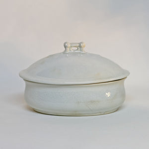 Gorgeous white antique IRONSTONE THREE-PIECE SOAP DISH made by MELLOR, TAYLOR AND COMPANY of Burslem Stoke-on-Tent in England. Set is in the shape of a small oval tureen and complete, including the drain and lid. Stamped dating the piece to between 1880-1904. Some staining, no chips.