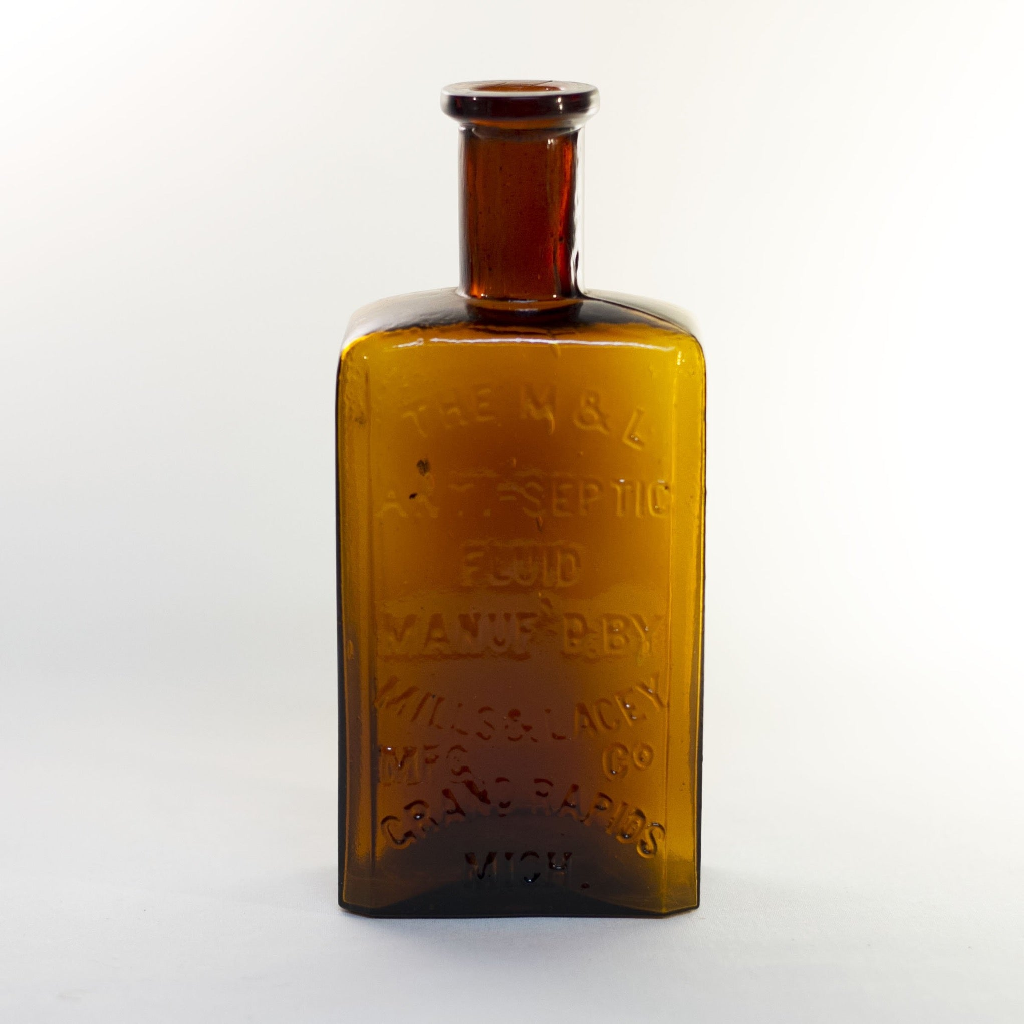 Antique Amber Glass M & L ANTI-SEPTIC Fluid Bottle for Embalming by Mills & Lacey Circa 1880s
