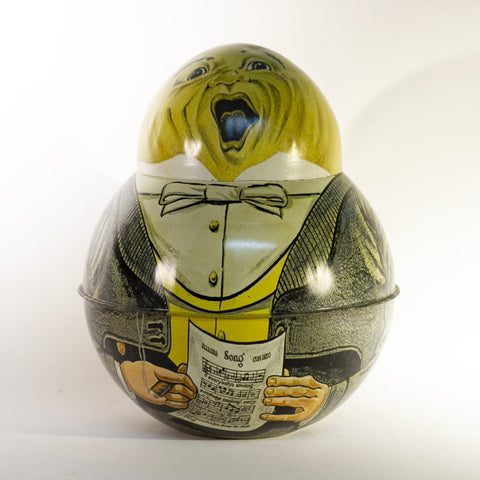 "TOBACCIANA COLLECTORS! Replica of antique ROLY POLY TIN DIXIE QUEEN TOBACCO CONTAINER TIN manufactured by Cheinco Housewares in 1970s. In the shape of a little round man, collector's refer to this lithograph design as the ""SINGING WAITER.""  Stands and 7"" tall and 6"" in diameter at the widest point."