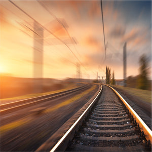 an image of a railway track on a sunny evening