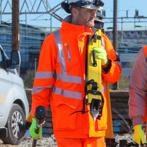 Man wearing PULSAR® high visibility orange coat
