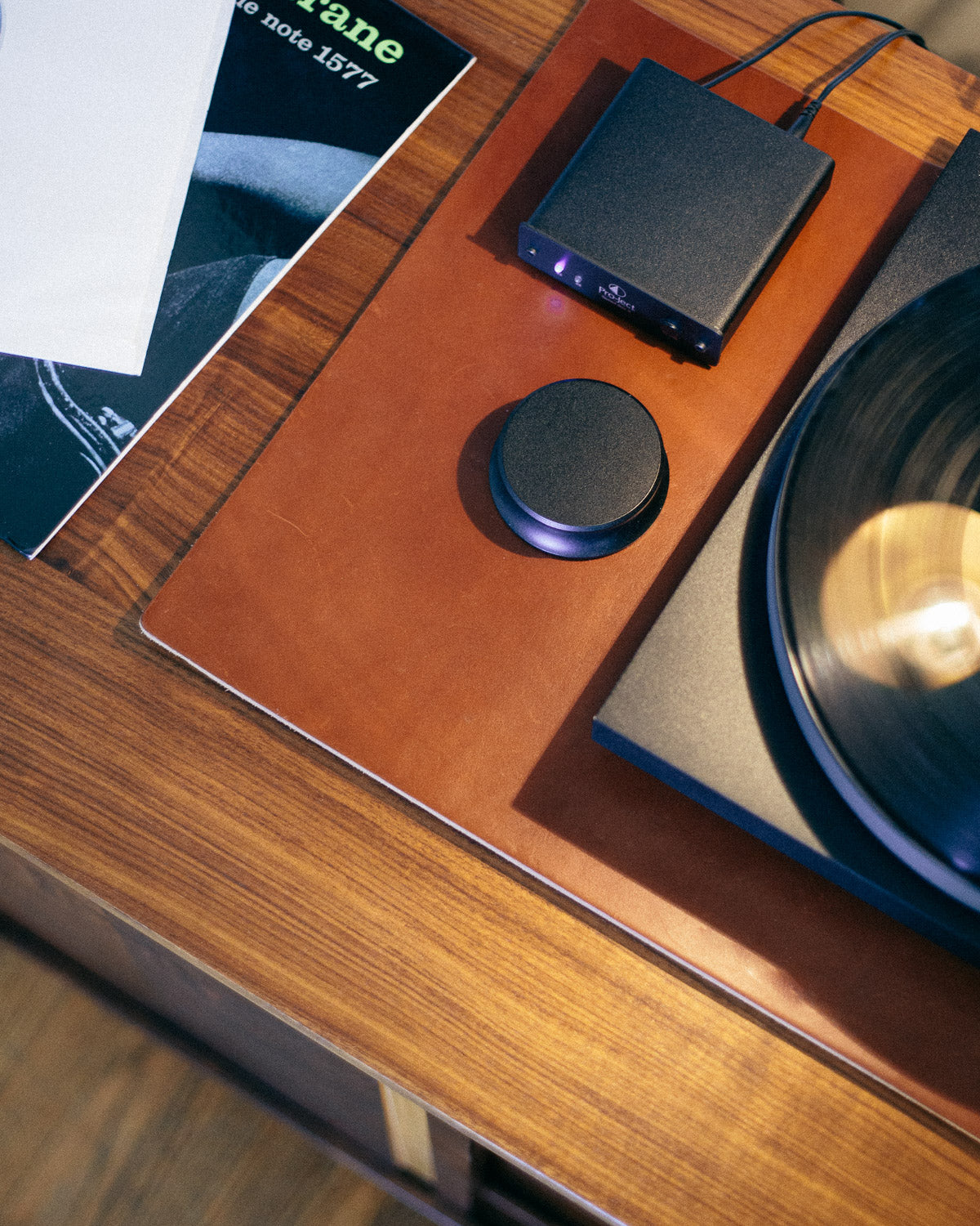 Leather desk mat, used under a turntable for vibration damping
