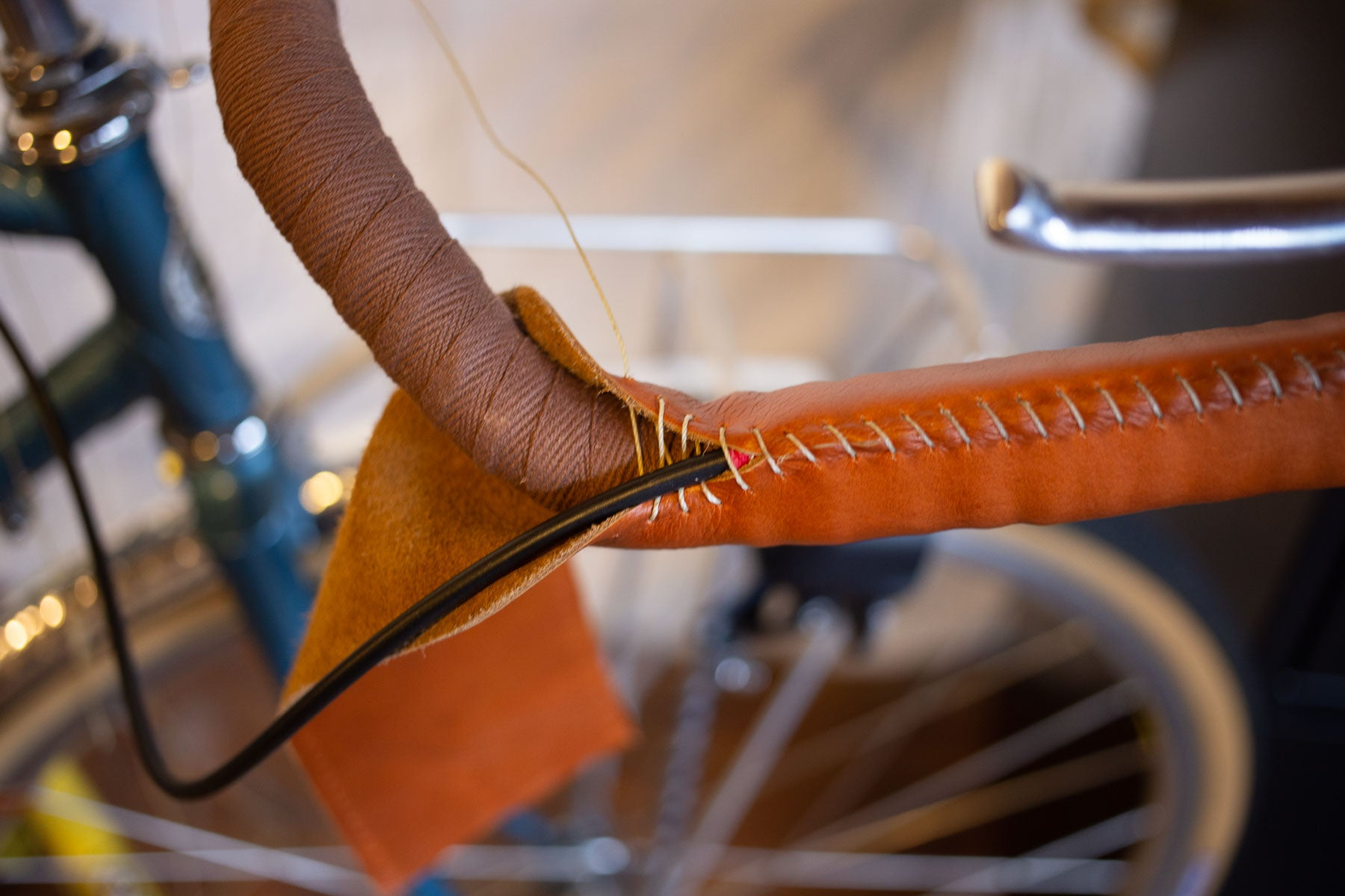 Progress in stitching leather handlebar wrap
