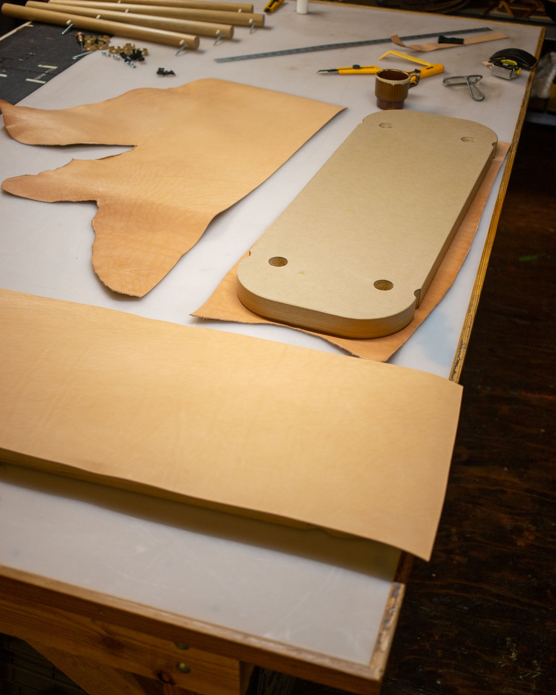 Cut your leather pieces to rough sizes large than your surface to be finished.