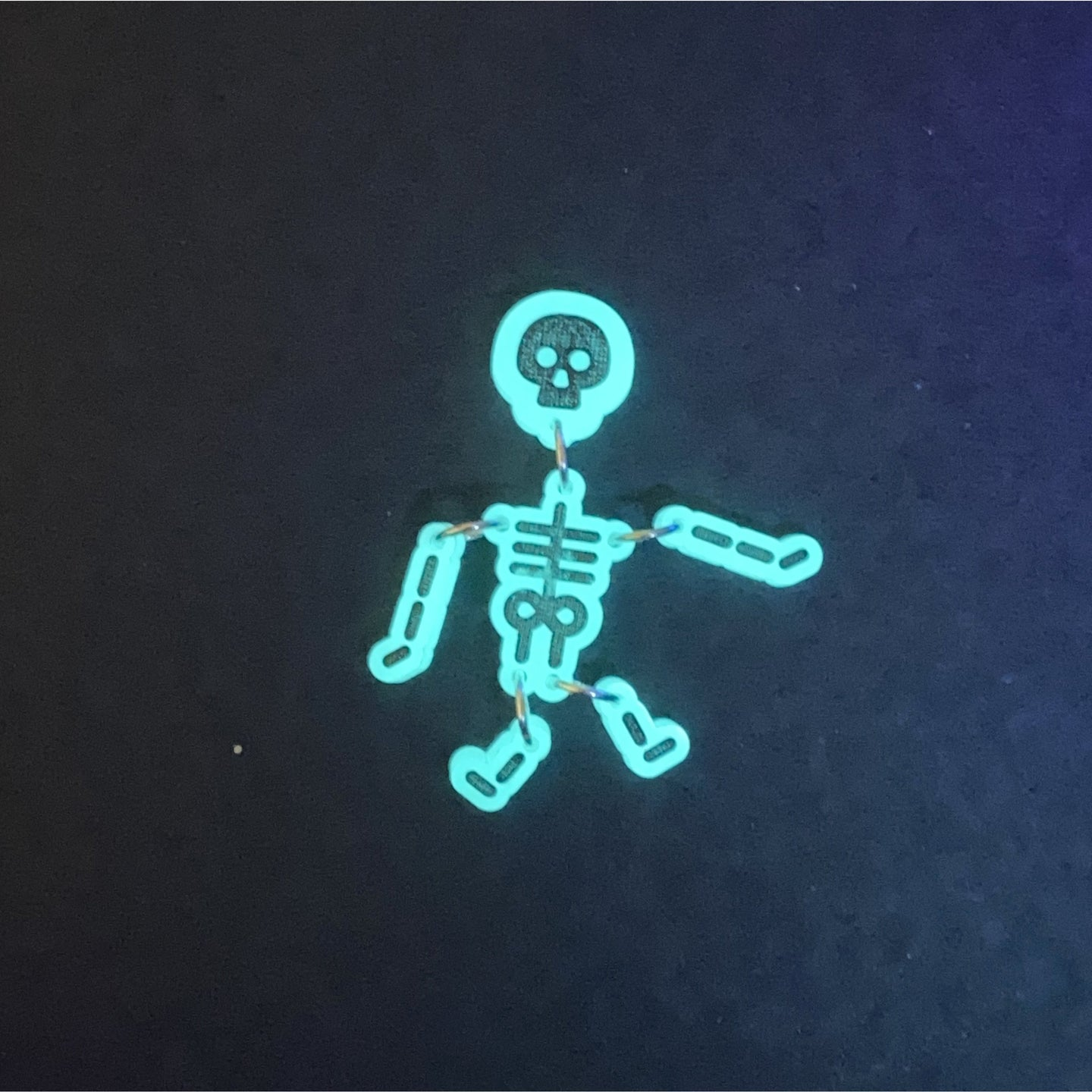 Glow in the dark skeleton badge