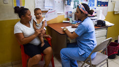 Blanca and her daughter receiving help at the health clinic