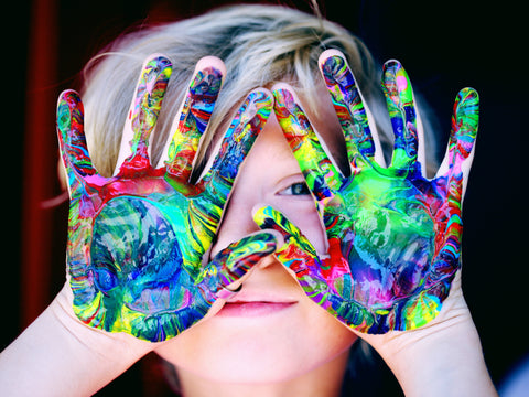 Kid's hands covered in paint