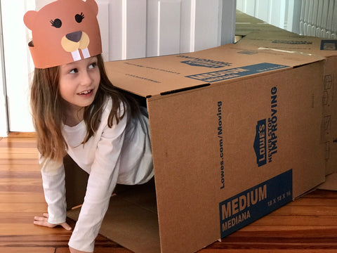 Child playing in box maze