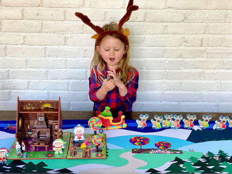 Child playing with Santa's workshop playset