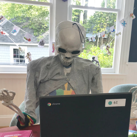 Skeleton in sweater remote learning