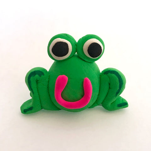 green frog made of clay
