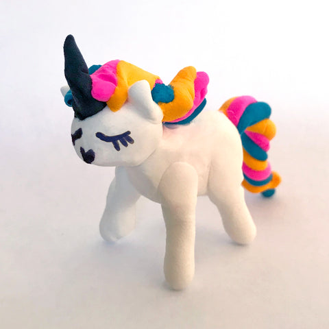 White rainbow unicorn made from clay