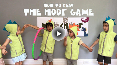 Kids in dino costume playing hula hoop game