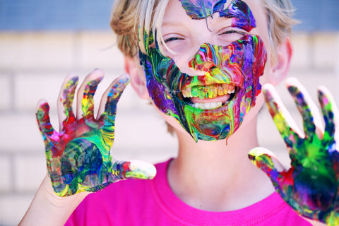 boy covered in paint as outdoor game