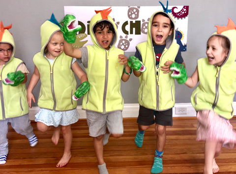 Children dressed as dinosaurs dancing