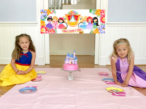 Meri Meri floral plates with a princess castle cake and kids dressed as princesses