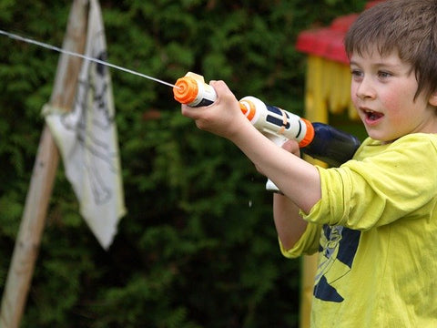 Boy shooting a water gun