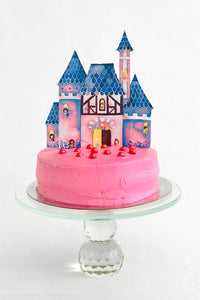 Princess cake topper on a pink princess cake